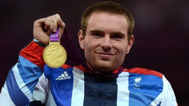 Making his country proud. Mickey with his Paralympic gold at the 2012 Games in London.